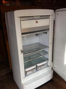 Probably has old, aluminum crank ice-cube trays in freezer. Sweet.