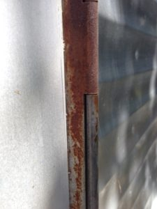 Since the under-carriage and tongue had already been treated for and protected against rust, this little door hinge is all I had to contend with.
